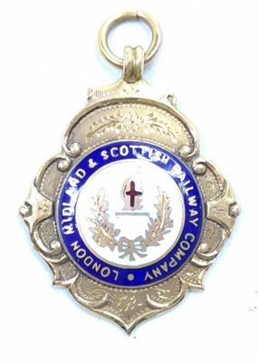 Lot 49 - A 9ct gold hallmarked LMS enamel Winners Medal,...