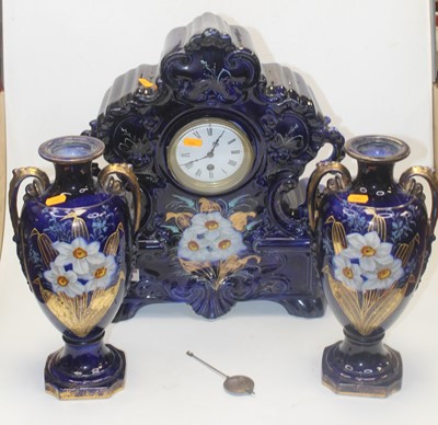 Lot 22 - An early 20th century clock garniture, the...