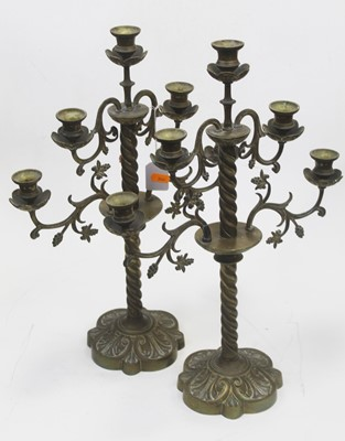 Lot 11 - A pair of 19th century brass five sconce table...