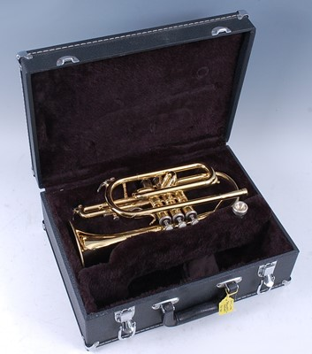Lot 524 - A Sonata brass cornet, in fitted leather case.