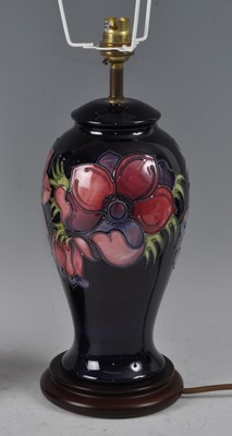 Lot 14 - A Moorcroft pottery table lamp, in the Anemone...