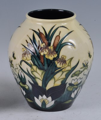 Lot 21 - A Moorcroft pottery vase, in the Lamia pattern...