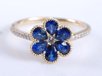 Lot A yellow metal, sapphire and diamond six-petal...