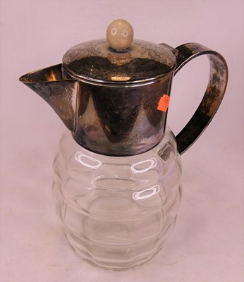 Lot 4 - A silver plated and glass water pitcher, h.29cm