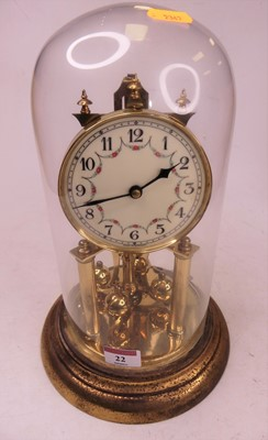 Lot 22 - A 20th century brass anniversary clock, housed...