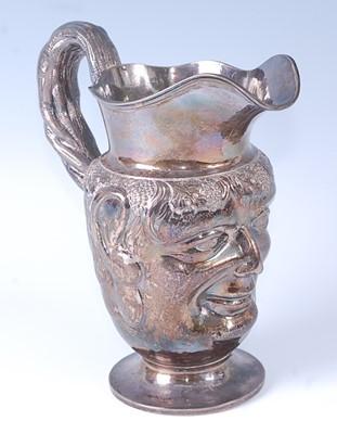 Lot * A George II silver Bacchus wine jug, the...