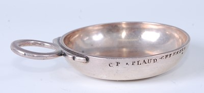 Lot * A mid-18th century French silver tastevin...