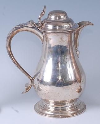 Lot * An early George III silver wine or beer jug,...