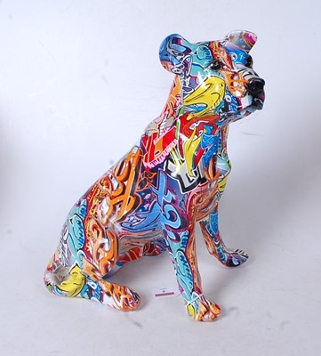 Lot 5 - A modern model of a seated dog, with all-over...
