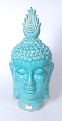 Lot 10 - A large modern turquoise glazed ceramic bust...