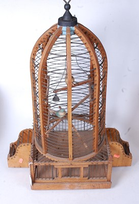 Lot 11 - A large softwood and wirework birdcage, of...