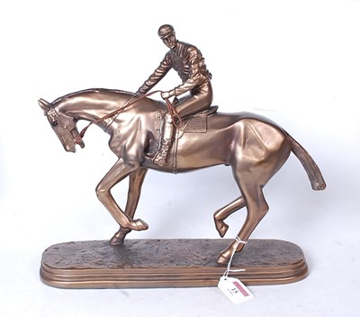 Lot 15 - A reproduction bronzed resin figure of a...