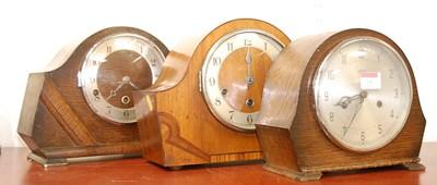 Lot 16 - A 1950s walnut cased mantel clock, having...