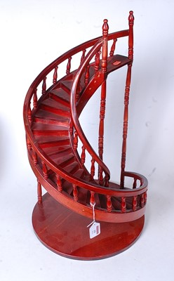 Lot 19 - A modern stained ply model of a spiral...