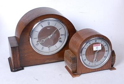 Lot 22 - A 1950s oak cased mantel clock, having a...