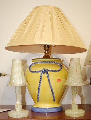 Lot 24 - A pair of onyx table lamps, each having a...