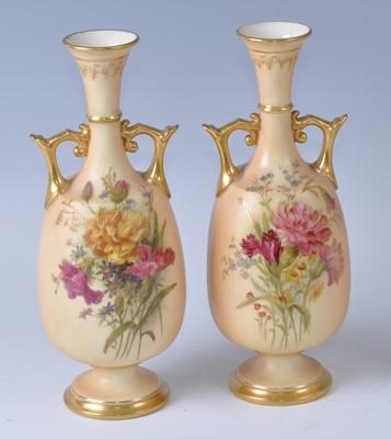 Lot A near-pair of Edwardian Royal Worcester blush...
