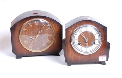 Lot 5 - A 1930s oak cased eight-day mantel clock, the...