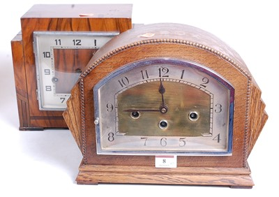 Lot 8 - A 1930s oak cased mantel clock, the eight day...