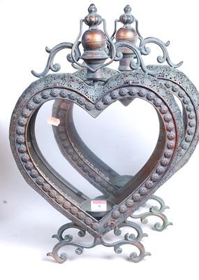 Lot 9 - A pair of modern copper-effect heart shaped...