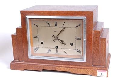 Lot 11 - A 1930s Art Deco oak cased mantel clock, of...
