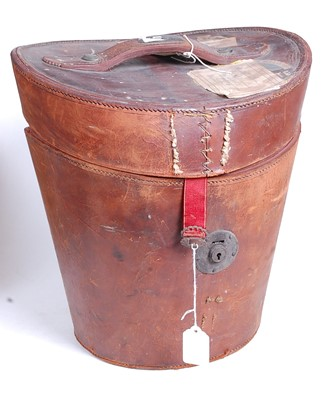 Lot 15 - A Victorian tan leather top-hat box, with...