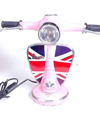 Lot 22 - A modern pink painted desk lamp in the form of...